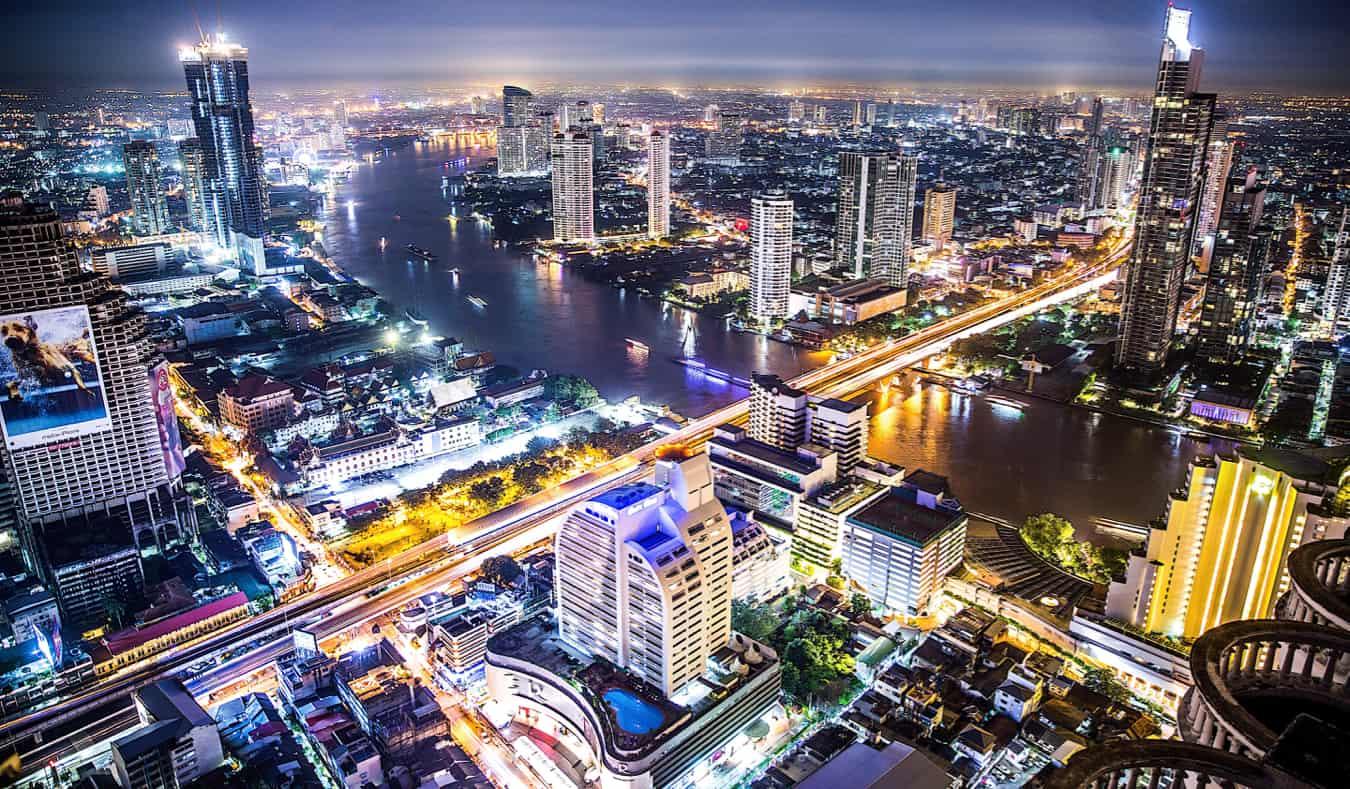 The bright, towering skyline of Bangkok, Thailand lit up at night