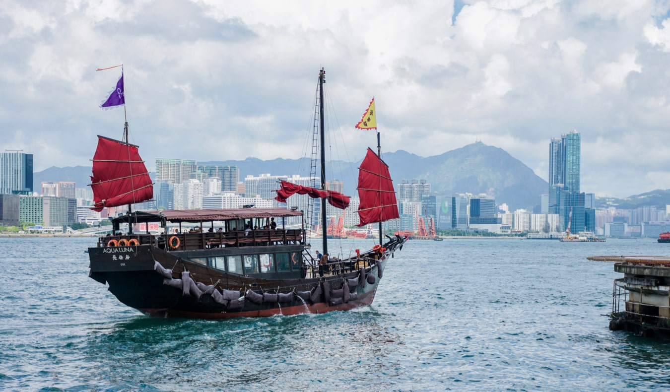 The famous Hong Kong junk boats sailing on the waters near Hong Kong
