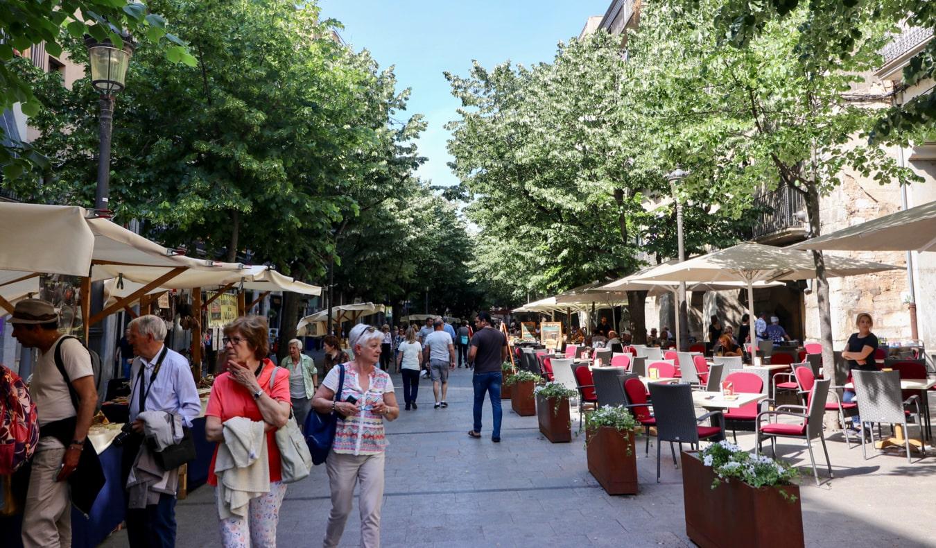 Tourists walking along La Rambla de la Llibertat in Girona, Spain
