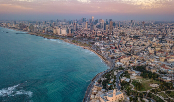 A aerial view of Tel Aviv in Israel during a colorful sunset