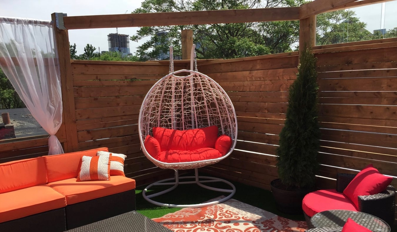 The outdoor common area of Two Peas Pod hostel in Toronto, Canada