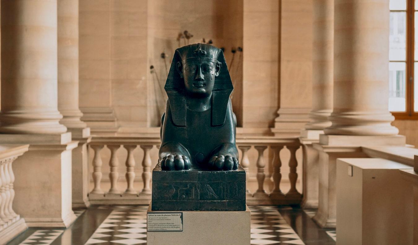 A sphinx statue in the Louvre museum, Paris