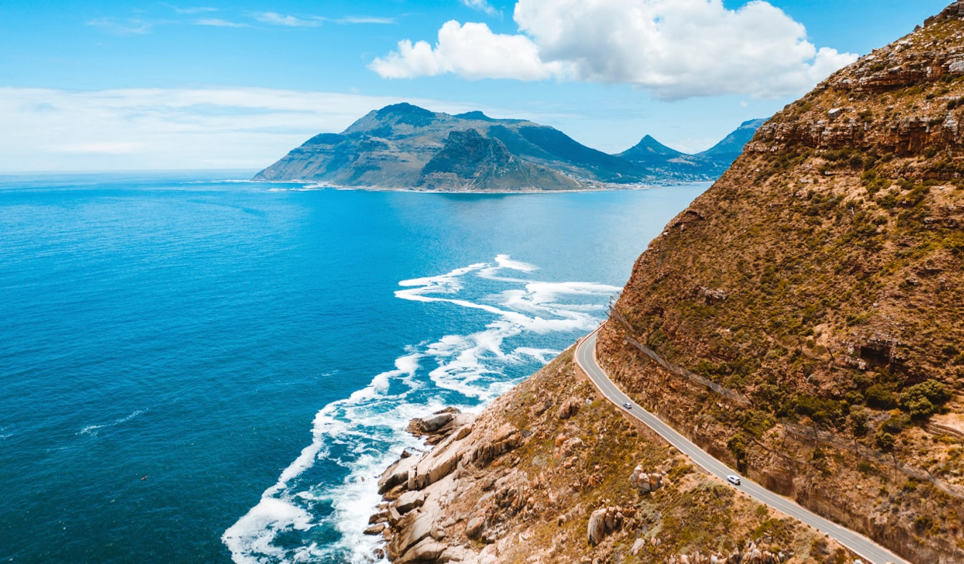 A car on the winding coastal highway in South Africa