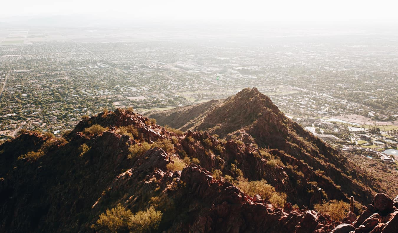 The view overlooking Phoenix from a rocky mountain above the city
