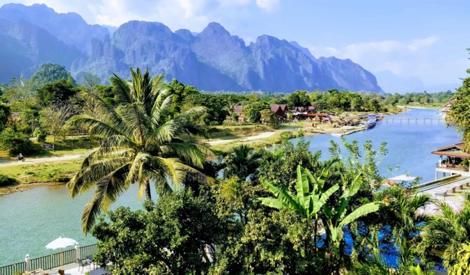 A river in Vang Vieng, Laos with mountains in the distance