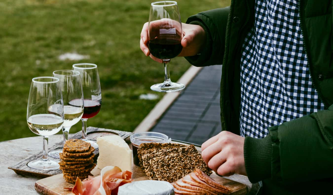 A cheese platter beside several glasses of Australian wine