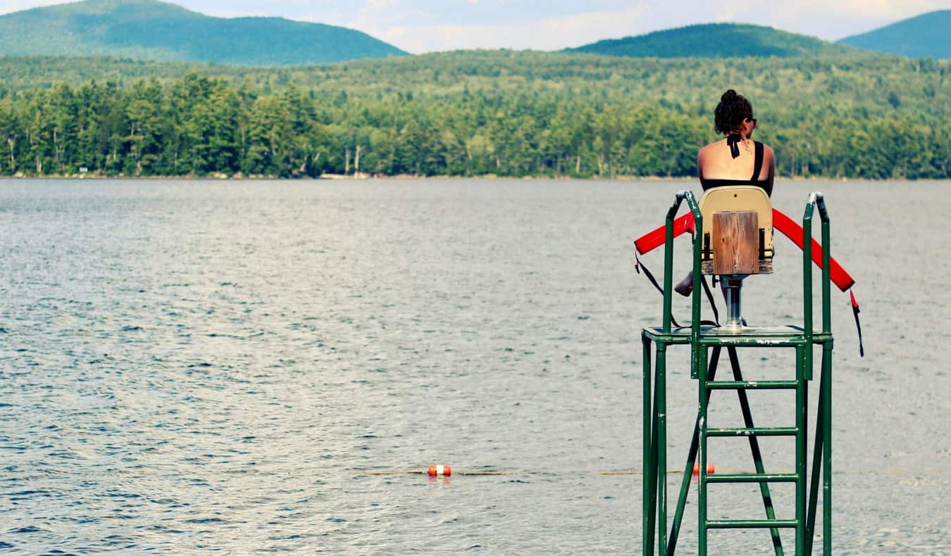 A lifeguard on duty at a small freshwater beach in the summer