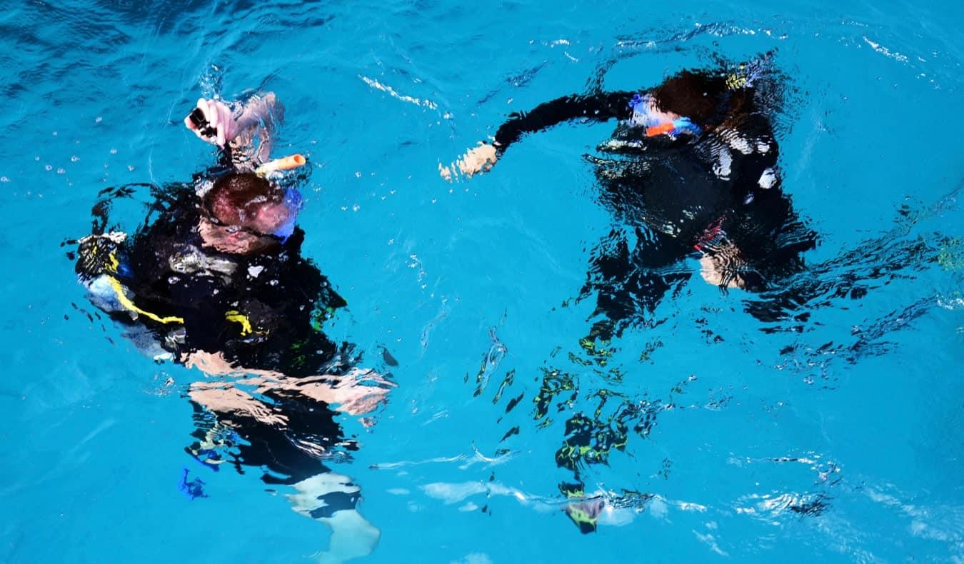 A pair of scuba divers preparing to dive in Australia