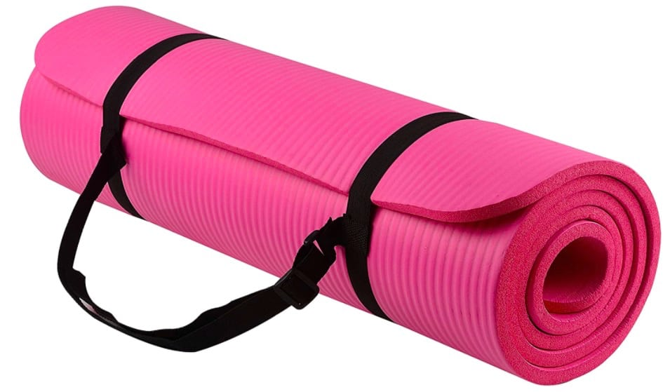 A pink yoga mat rolled up