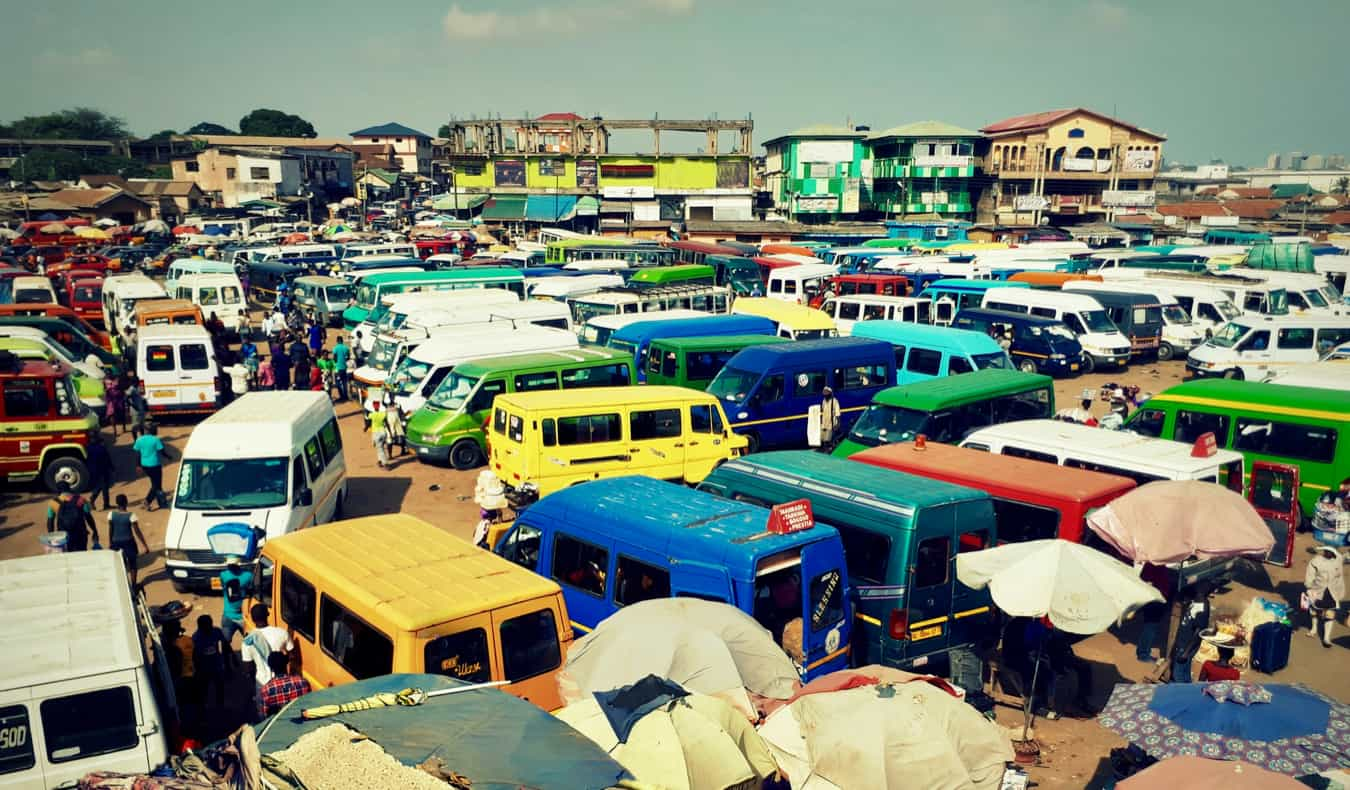 A parking lot full of minibuses in Ghana, Africa