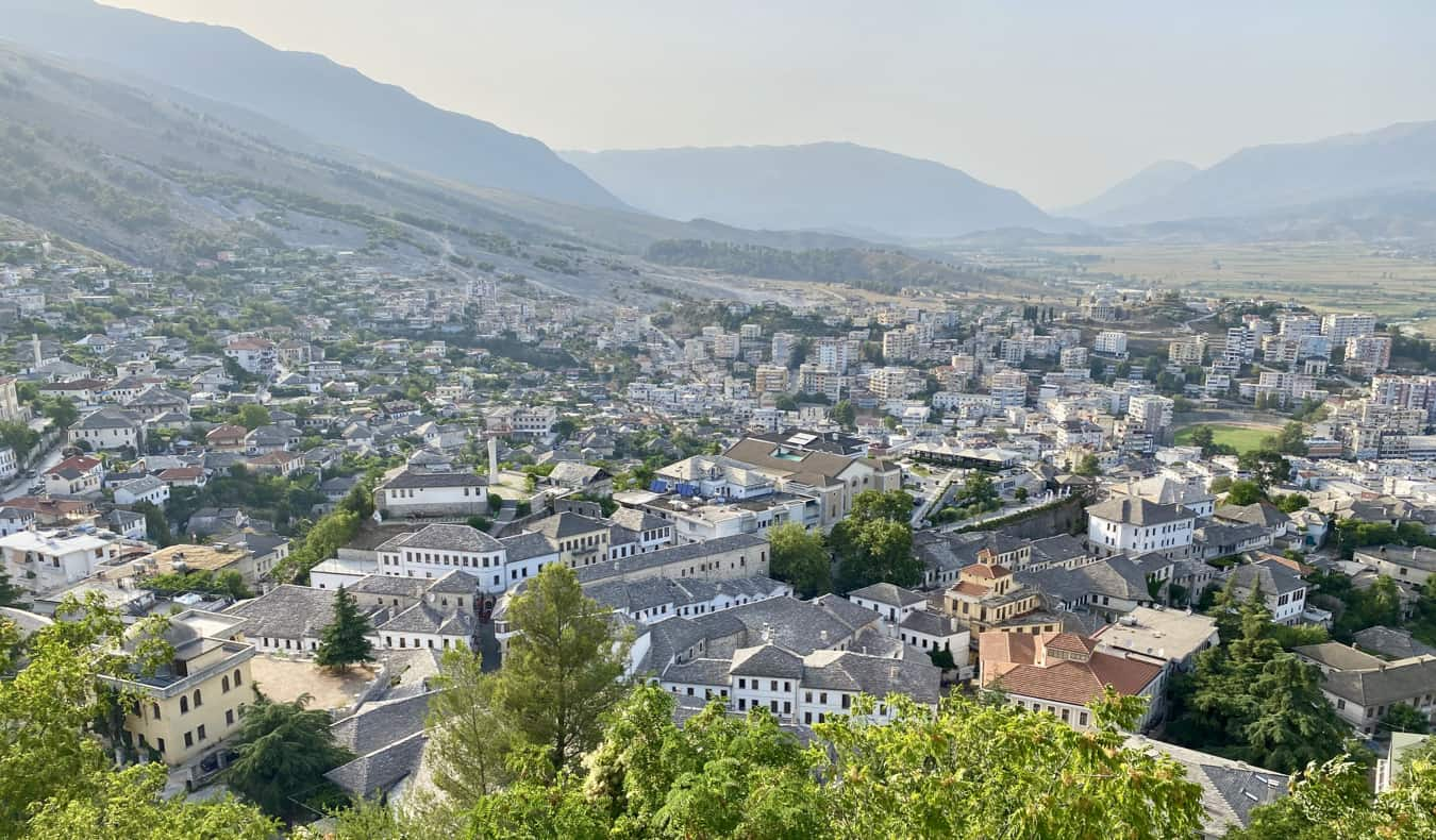 The view overlooking a small town in Albania surrounded by lush mountains