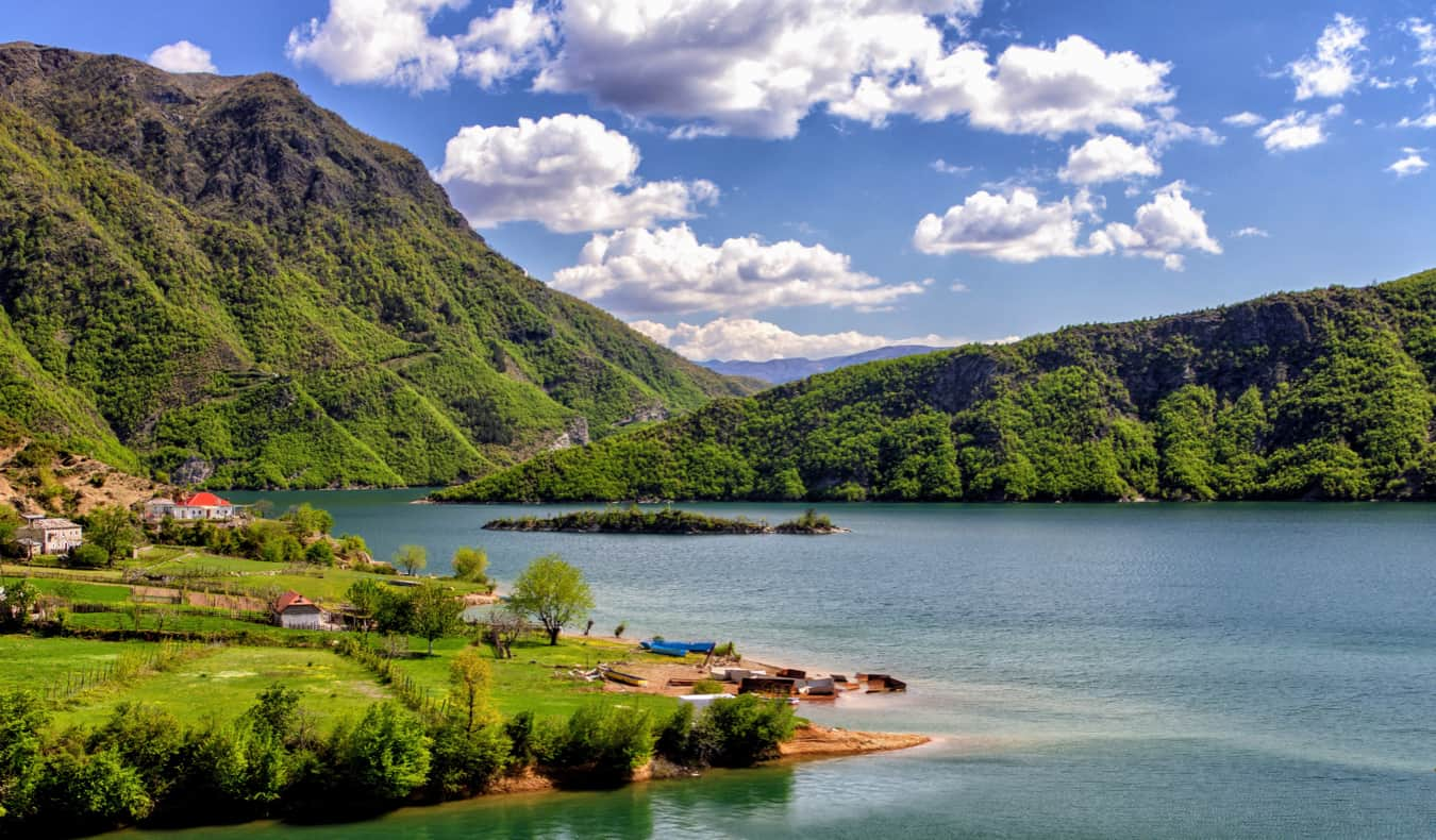 A serene lake surrounded by lush greenery in Albania