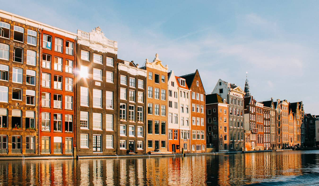 Row of townhomes in Amsterdam, Netherlands along a historic canal