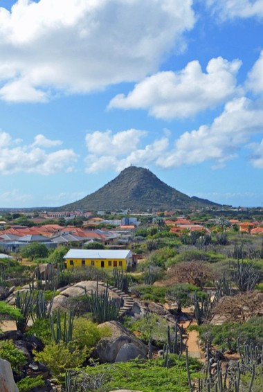 The view overlooking Aruba towards Hooiberg hill in the distance