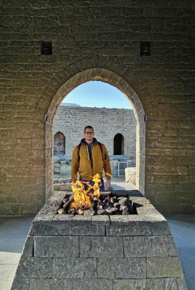 A solo traveler standing at Ateshgah Palace in Azerbaijan