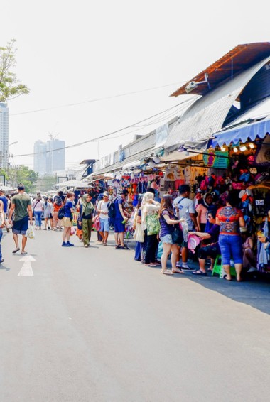 Tourists and locals at the Chatuchak Market in Bangkok, Thailand