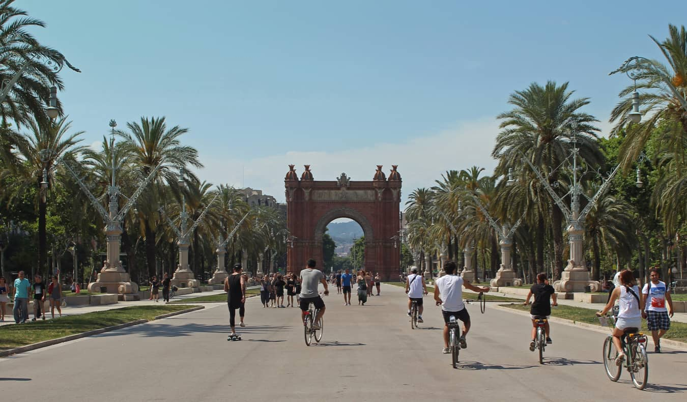 People riding bikes around Barcelona, Spain in summer
