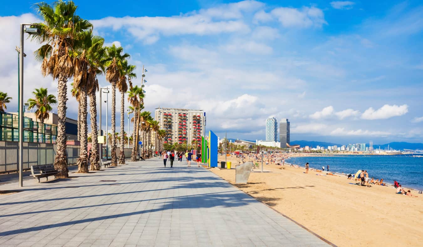The iconc La Barceloneta beach along the shore of Barcelona, Spain