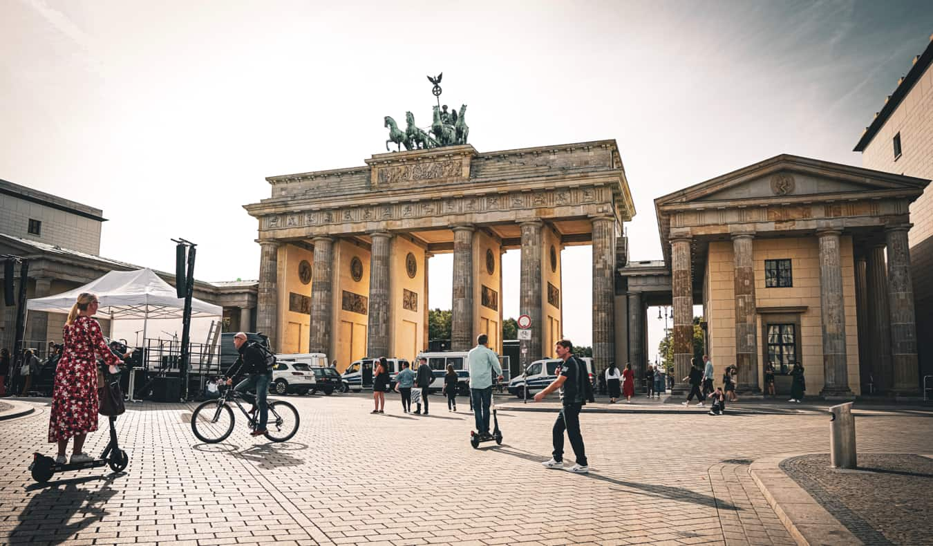 People walking and cycling near the Brandenburg Gate in Berlin, Germany
