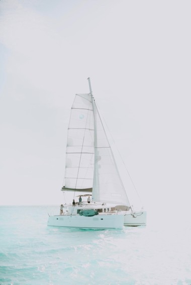 A sailt boat in the calm waters of the BVIs