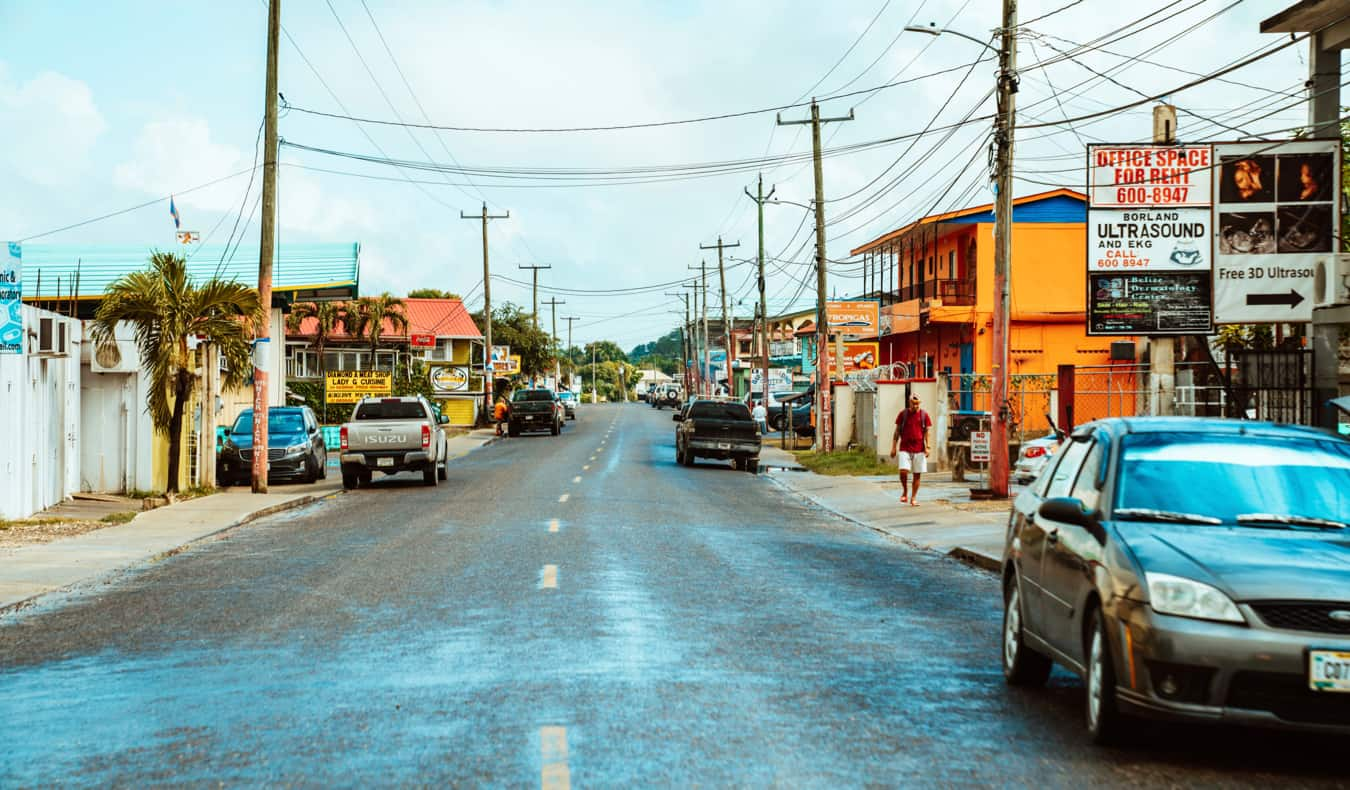 Cars parked on the road in Belize in Central America
