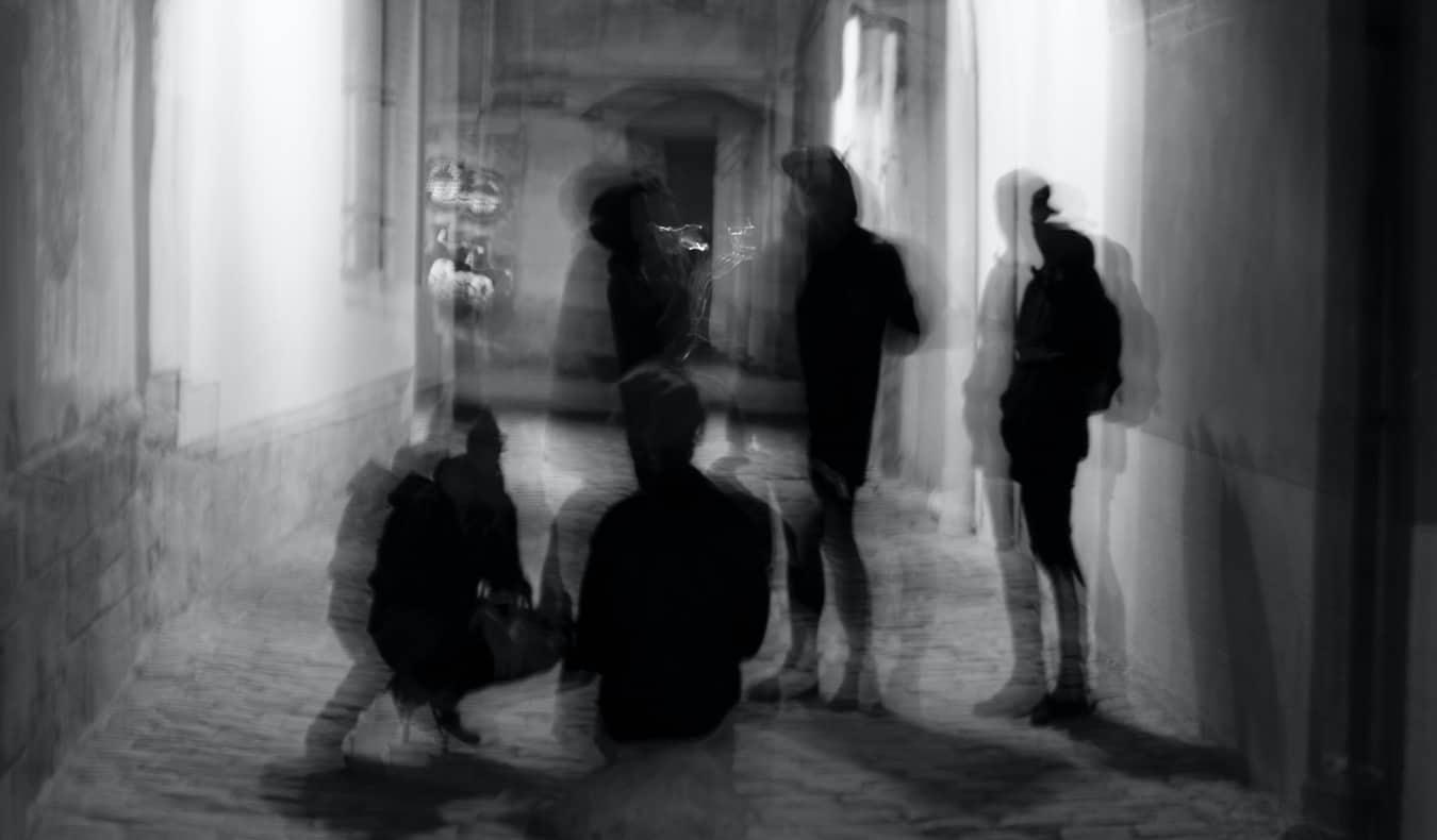 A long exposure shot making pedestrians look like ghosts