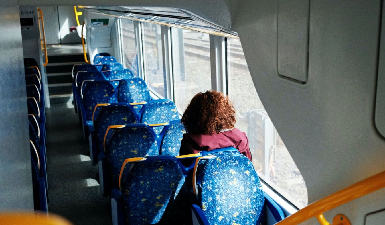 A woman riding public transit in Sydney, Australia