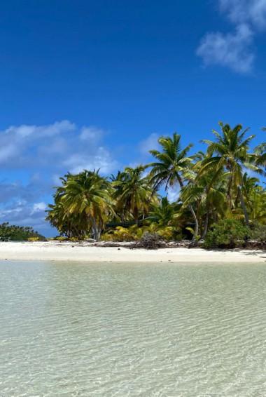 A sunny beach on Aitutaki Island in the Cook Islands