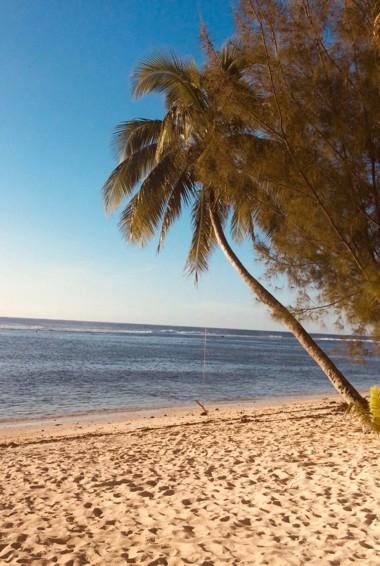 The white sand beach on Rarotonga Island in the Cook Islands