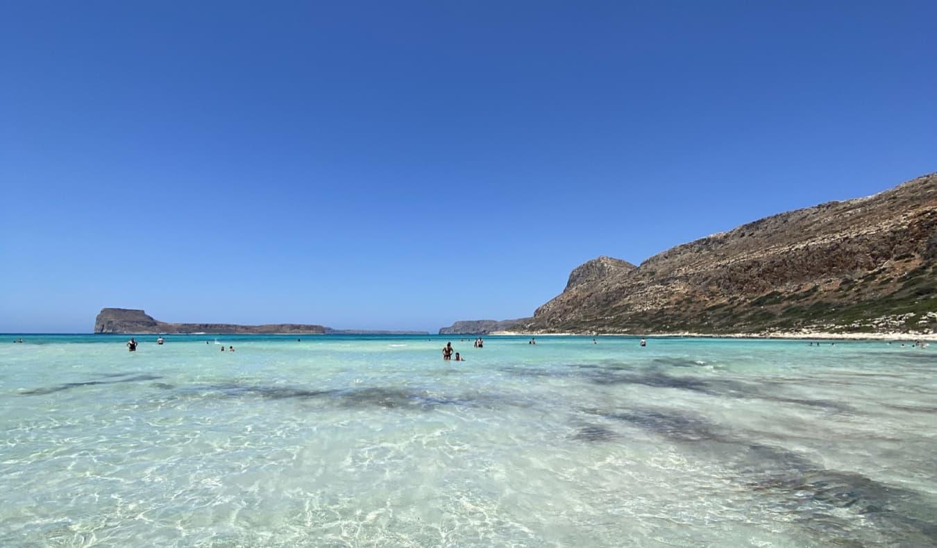 A clear, calm beach in Crete on a sunny day
