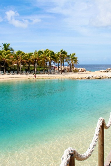 The clear, calm water of Mambo Beach in Curacao