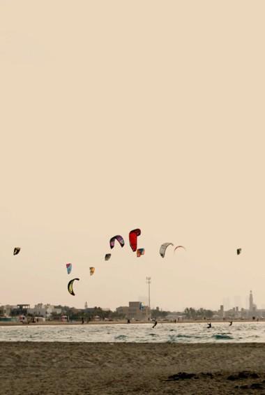 Kite surfers on Kite Beach in Dubai, UAE