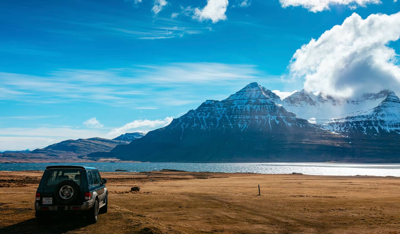 A car parked near the mountains in Iceland