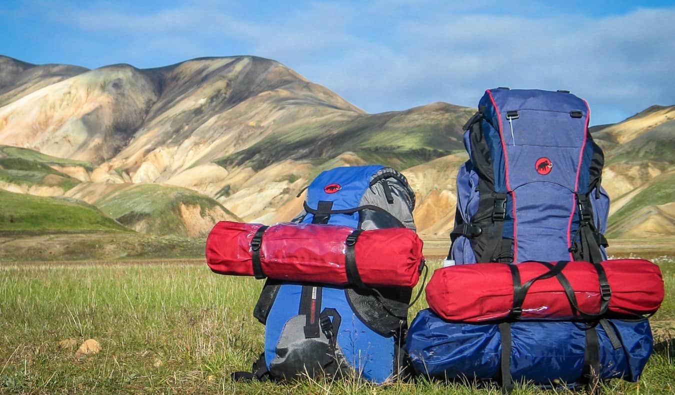 A bunch of hiking gear in an empty field