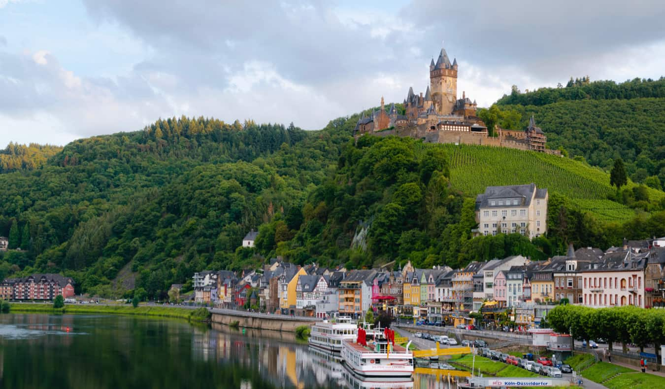 A scenic vista of a castle overlooking a small village in Germany