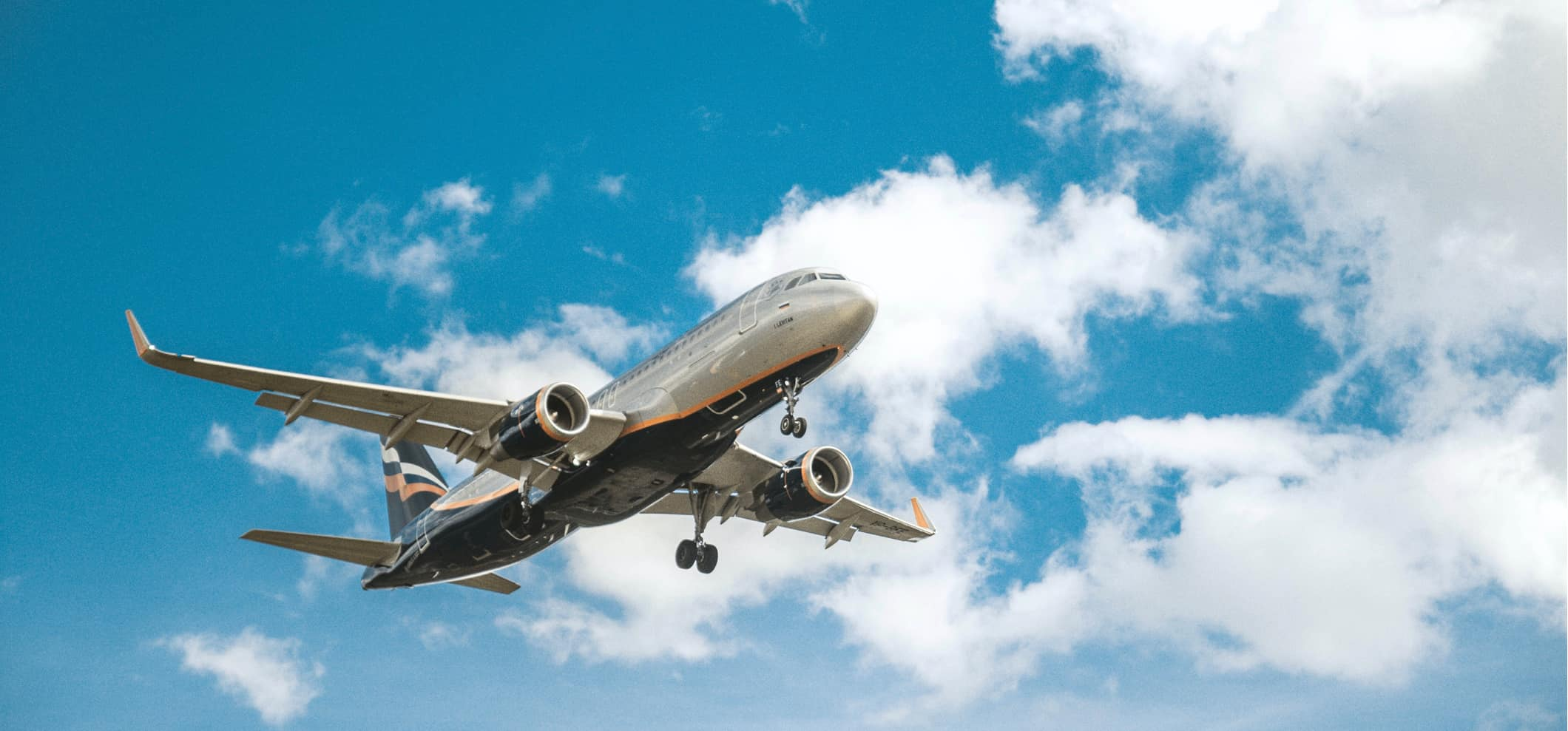 A commercial airplane landing at an airport on a bright summer day