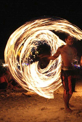 A local spinning fire at the Full Moon Party in Thailand