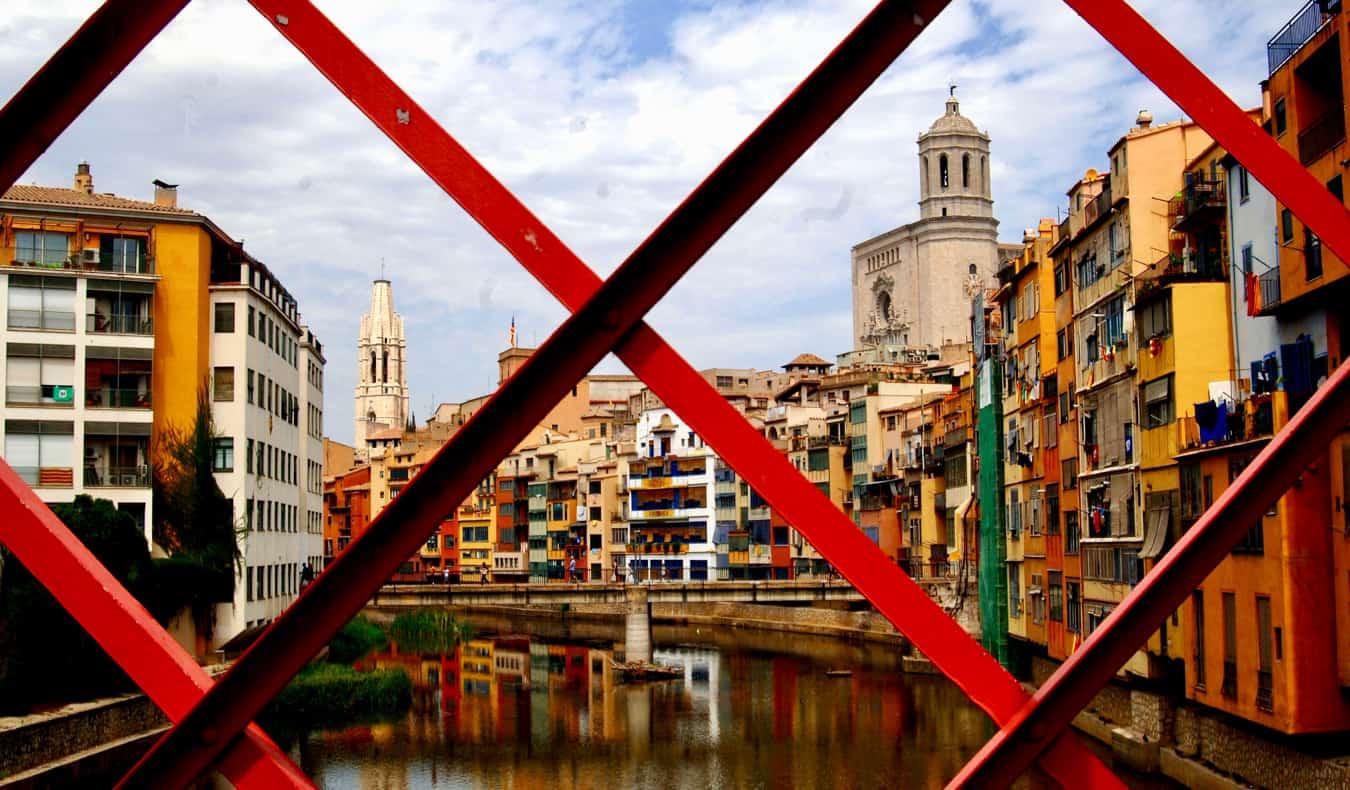 The bright red Eiffel Bridge in Girona, Spain