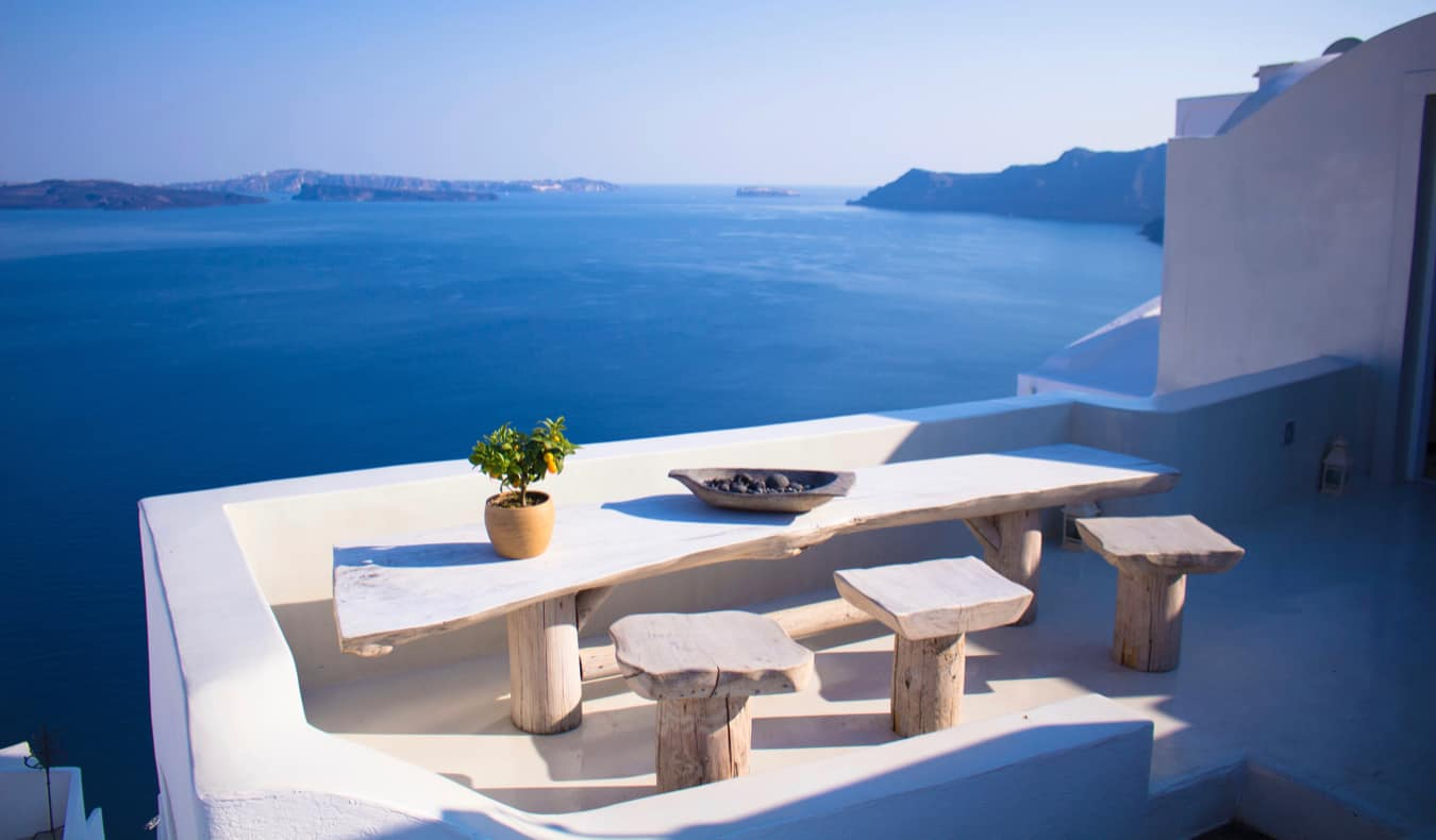 The view of the calm waters of Santorini from a charming balcony