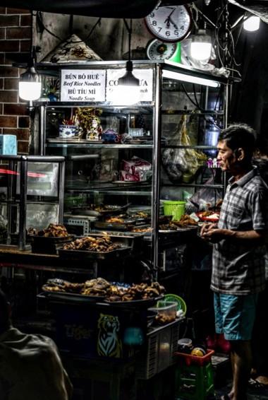 A local man cooking street food in Saigon, Vietnam