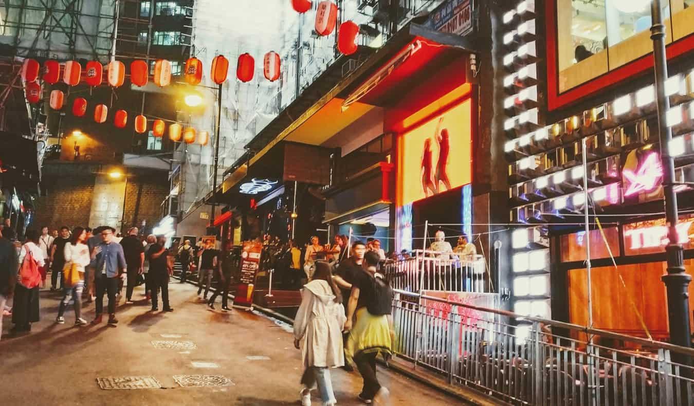 People enjoying the Lan Kwai Fong district in Hong Kong at night