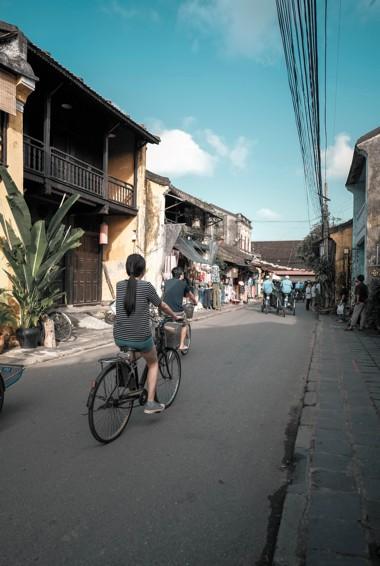 Locals riding bikes in Hoi An, Vietnam