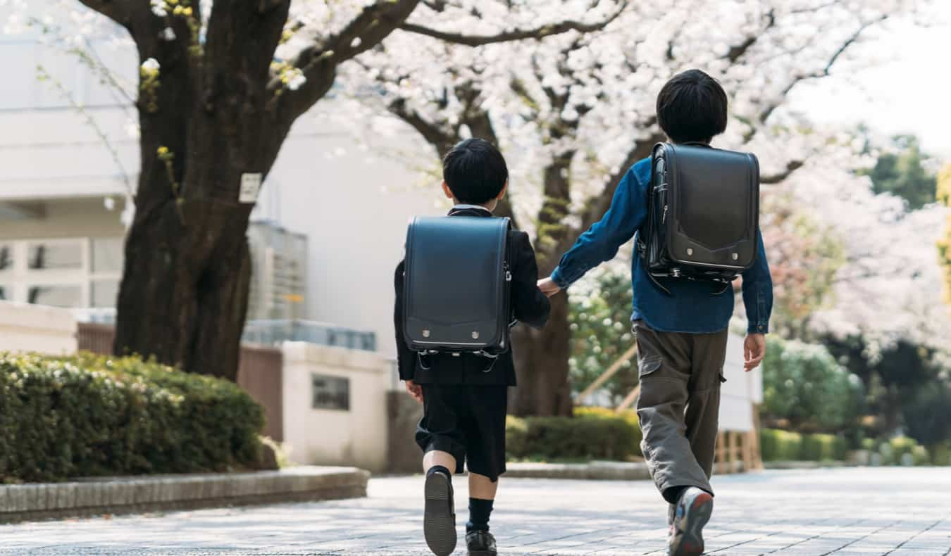 Two young students walking to school in Japan