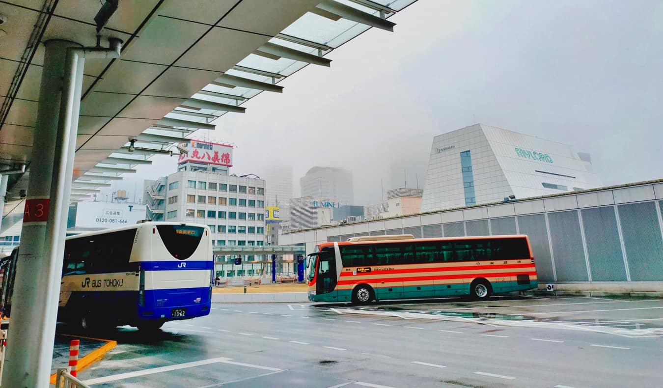 A coach bus ina parking lot in Japan