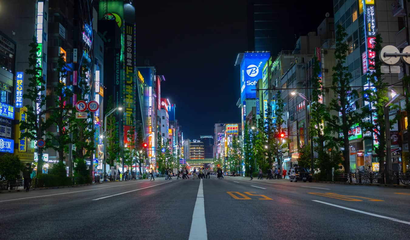 The blurred lights of an empty road in Japan at night