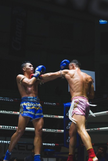 Two Muay Thai boxers fighting in a ring