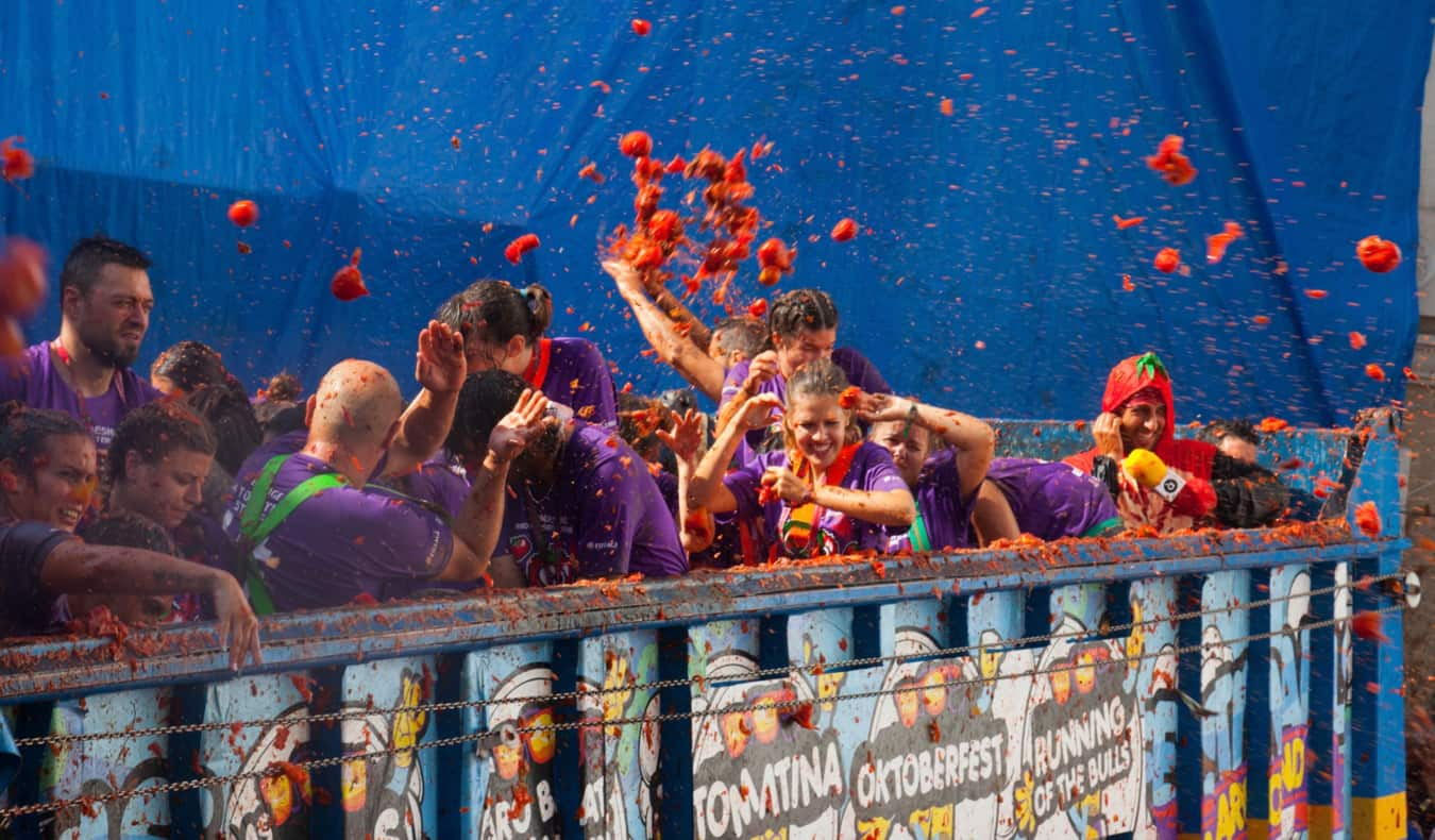 People throwing tomatoes during La Tomatina in Spain