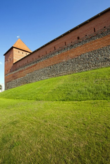 The red exterior of Lida Castle in Belarus