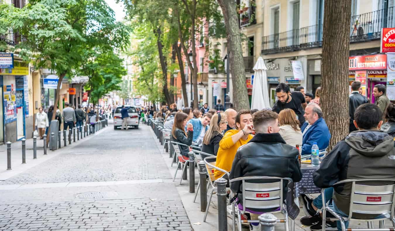 People lounging at a cafe in Lavapiés in Madrid, Spain