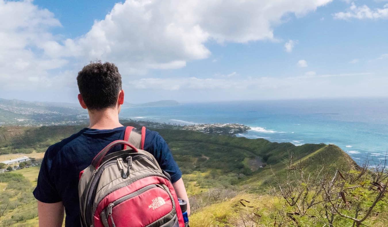 Nomadic Matt hiking near the ocean in Hawaii, USA